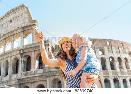 Happy Mother And Baby Girl Sightseeing Near Colosseum In Rome, I