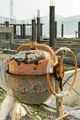 stock photo of mixer  - Dirty concrete mixer on a building site - JPG