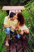 image of pier a lake  - Couple of young lovers on the pier of the lake  - JPG