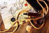 image of spyglass  - Marine still life spyglass and world map on wooden background - JPG