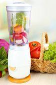 stock photo of blender  - Blender with fresh vegetables on kitchen table - JPG
