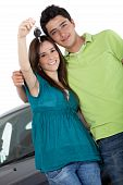 stock photo of car key  - Couple with a car holding keys  - JPG