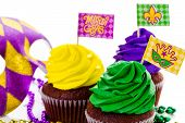 picture of icing  - Cupcakes decorated with bright color icing for Mardi Gras party - JPG