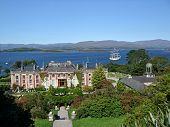 picture of ireland  - Bantry House in Ireland with sailboat in behind - JPG