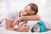 stock photo of early-man  - Close up photo of tired and sleepy young man - JPG