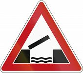 image of movable  - Old design of a German sign warning about a movable bridge - JPG
