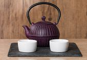 picture of teapot  - Chinese traditional teapot and cup on wooden background - JPG