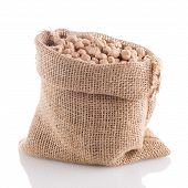 stock photo of chickpea  - Uncooked chickpeas Uncooked chickpeas on burlap bag on white background - JPG