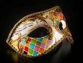 picture of harlequin  - Venetian mask harlequin style isolated on black background - JPG