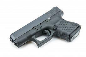stock photo of pistols  - automatic 9mm - JPG