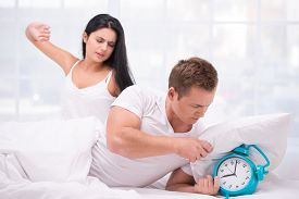 picture of early 20s  - Photo of young sleepy couple early in the morning - JPG