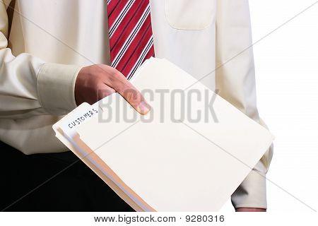Man Giving A Folder