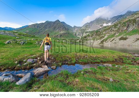 Trekking In The Mountains Near A Creek Pond