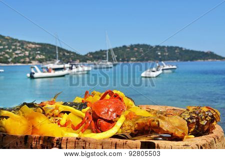 Bouillabaisse on the sea background