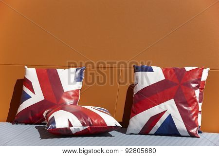 Chill Out Zone With British Colors Cushions And Orange Wall