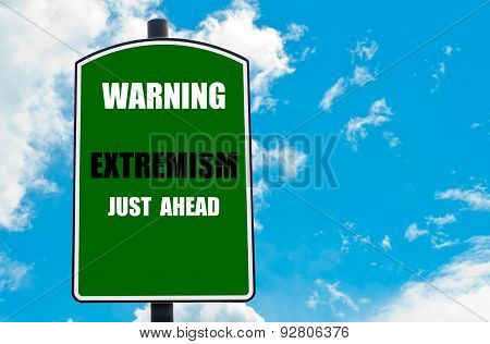 Warning Extremism Just Ahead Written On Road Sign