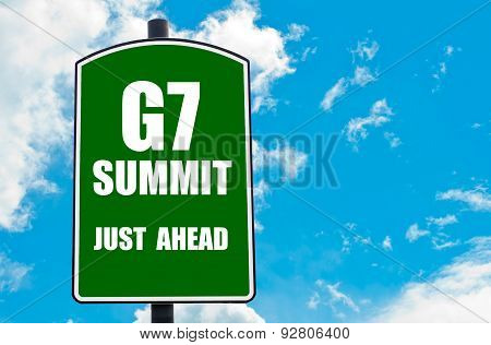 G7 Summit Just Ahead Written On Green Road Sign