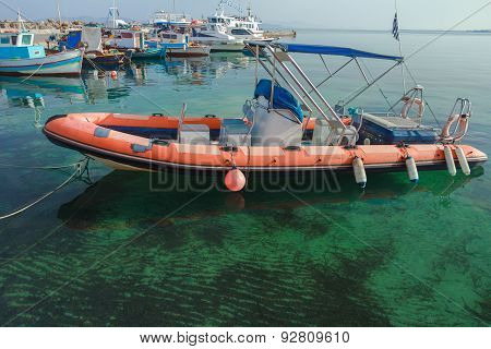 Rigid-hulled Inflatable Boat Floating On Calm Blue Transparent Sea Water Of Greek Kos Island