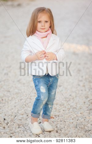 beautiful trendy baby girl with blonde hair outdoors. Little girl 2-3 year old