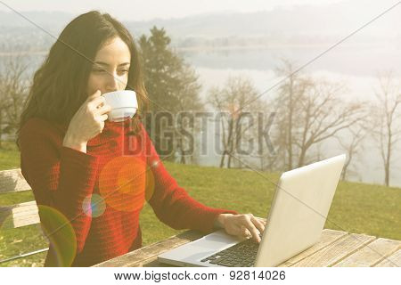 Woman Working On Laptop Outdoors
