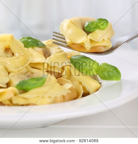 Italian Cuisine Eating Tortellini Pasta Noodles Meal With Basil