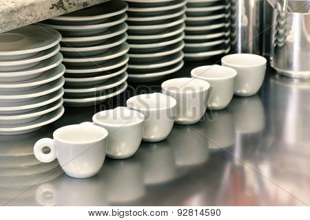 Small Coffee Cups On A Metal Cafeteria Counter