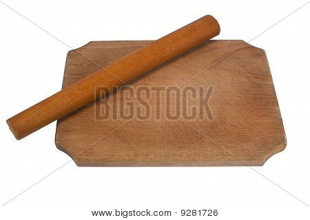 Rolling pin on wooden board