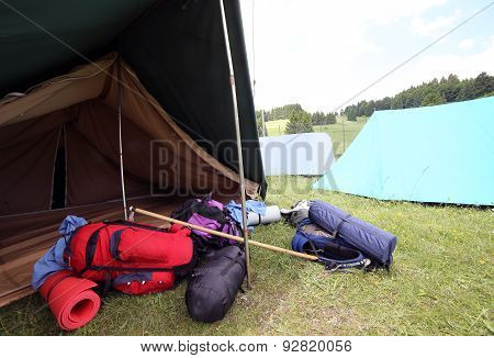 Backpacks And Sleeping Bags Outside The Camping Tent