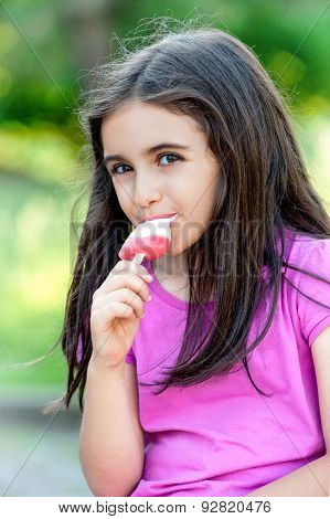 Friendly Little Girl Enjoying A Frozen Lolly