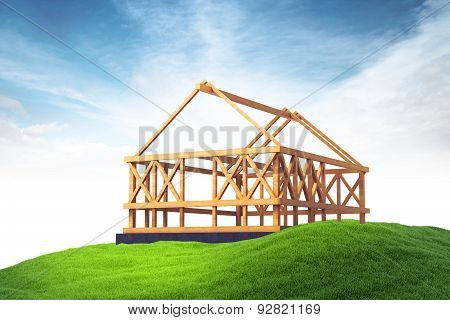 Wooden Framing For Construction Of New House On Grass On Sky Background
