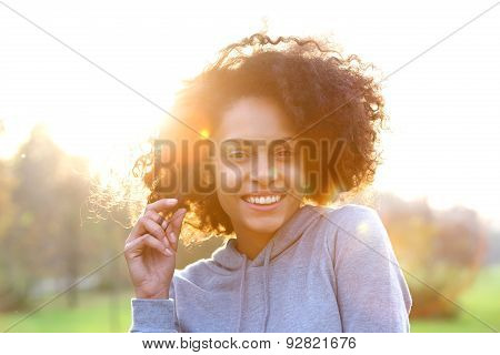Smiling Young Black Woman With Curly Hair