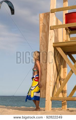 Young Woman On The Wooden Rescue Tower.