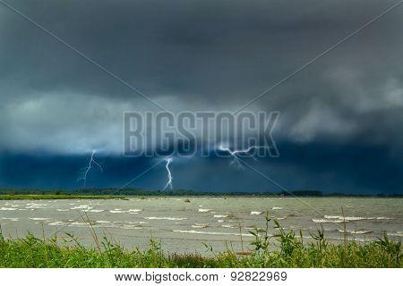 Lightning At Sea. Curtains On The Coast.