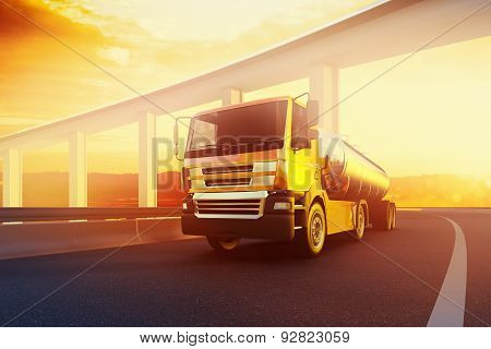 Orange semi truck with oil cistern on asphalt road highway at sunset - transportation background