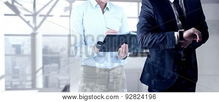 Handsome businessman checking the time against airport terminal