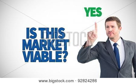 Focused businessman pointing with finger against white background with vignette