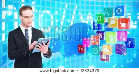 Unsmiling businessman using tablet pc against digitally generated black and blue matrix