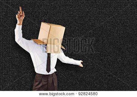 Anonymous businessman with arms out against black background