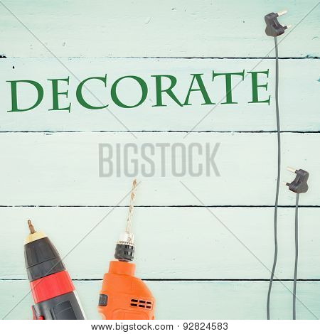 The word decorate against tools on wooden background
