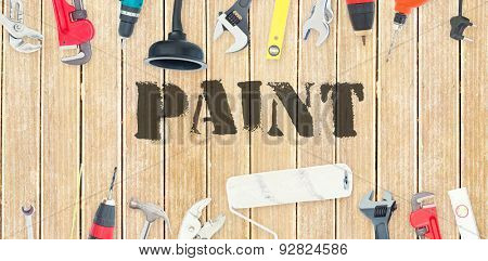 The word paint against diy tools on wooden background
