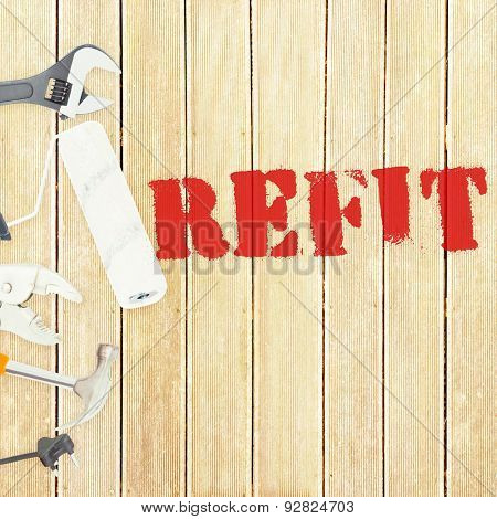 The word refit against tools on wooden background