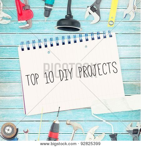 The word top 10 diy projects against tools and notepad on wooden background