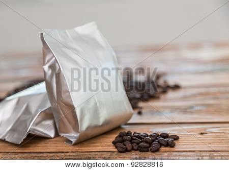 New coffee foil bag on wood table