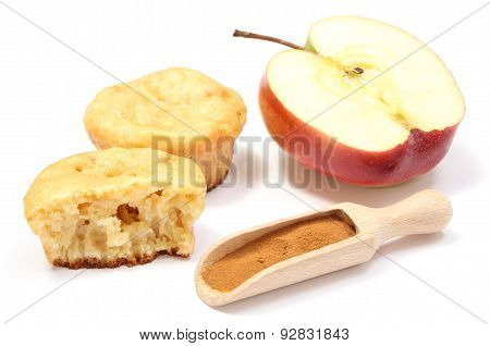 Baked Muffins, Fresh Apple And Powdery Cinnamon On White Background
