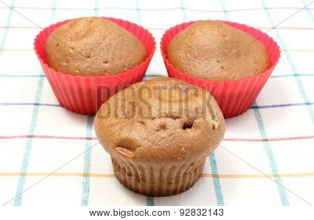Fresh Baked Coffee Muffins On Colorful Cloth