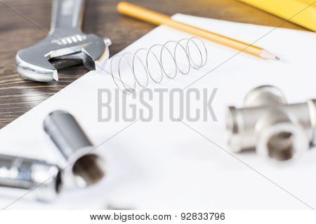 All kinds of plumbing and tools on white paper