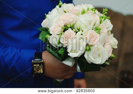 Wedding Bouquet On Hands Of Groom