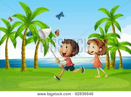Children trying to catch butterflyy in an open area