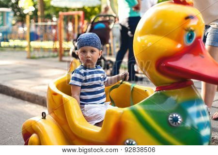 Boy Driving Toy Duck
