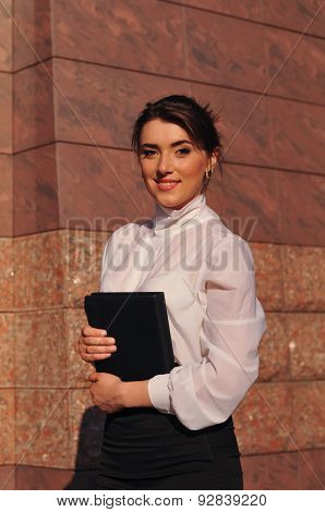 Pretty Business Woman Portrait Near Wall